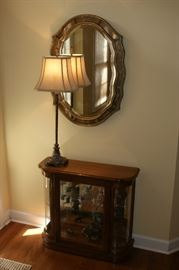 Framed wall mirror, lamp, curio cabinet
