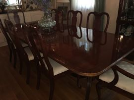 Lexington dining room banquet table with decorative border and 12 matching chairs