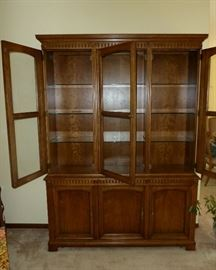 Solid wood china cabinet with glass doors and shelves plus bottom storage, by Kindel.