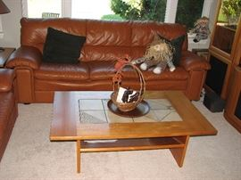 leather sofa, teak coffee table