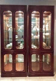 Two lighted china cabinets with beveled glass.