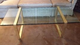 Glass coffee table with brass legs