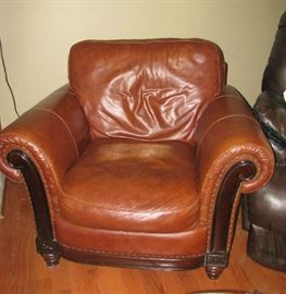 Leather chair also has an ottoman
