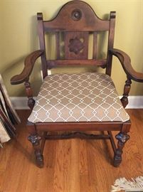 CAPTAINS CHAIR THAT MATCHES THE TABLE AND OTHER CHAIRS