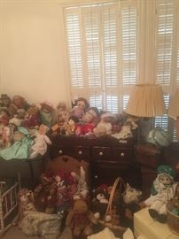 Large assortment of vintage dolls.