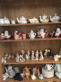 Large collection of English tea pots, cups and saucers.