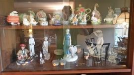 Collection of various porcelain and crystal manufacturers like Lladro, Royal Doulton, Beatrix Potter, Lalique, Sabino and Belleek.