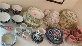 Various earthenware and porcelain dinner sets.