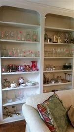 Example of bookshelves loaded with glassware, crystal, porcelain, etc.