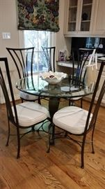 Contemporary iron and beveled glass breakfast group.