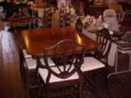 Mahogany dining table w/6 shield back chairs.
