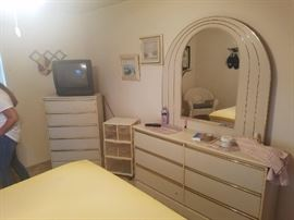 Bedroom set. There are also two night stands and a headboard.