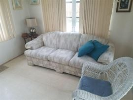 White and pastels sleeper sofa. Mattress inside, have yet to see condition. One of two wicker chairs, very sturdy and great condition. One of 4 very nice lamps. Bombay company vintage drop leaf mahogany side table.
