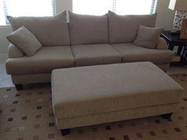 Family room sofa and ottoman.