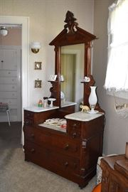 Carved walnut dresser w/3marble tops & mirror