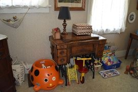 sewing machine ( cabinet only) & assorted toys