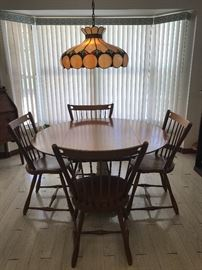 "Chairs by Sprague& Carleton "" Solid Rock Maple""  Drop leaf table is 48 wide as shown, drop leafs 12' each, has an iron base that has been married to table"