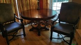 Beautiful ornate round dining table, 2 Louis IV style leather/suede armchairs w/ nail head trim.