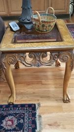 2 - side tables, ornately carved with glass inserts