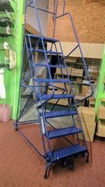 8 step rolling staircase. In excellent condition.