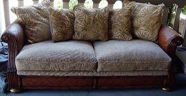 Elegant ourdoor/indoor sofa with wicker accents