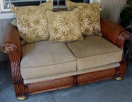 Elegant outdoor/indoor love seat with wicker accents. REMOVED!