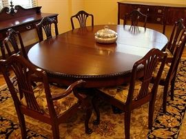 Terrific and rare 60 in wide pedestal mahogany table and 8 matching chairs-all completely restored. It goes from round to 9ft long with 4 matching leaves!