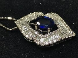 "Blue Sapphire pendant is in 18k gold. The Sapphire is 1.43 and the diamonds are 2 ctw. The chain is 14k and is 16"". This has been appraised by a certified gemologist and the appraisal will be available to the purchaser."