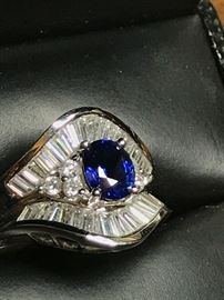 Blue Sapphire ring in 18k white gold. Diamonds are 1.18 ctw and the Sapphire is  .93 carat. This has been appraised by a certified gemologist and the copy will be available to the purchaser.  Size is 6 1/2.