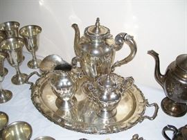 Sterling tea set - one of two.