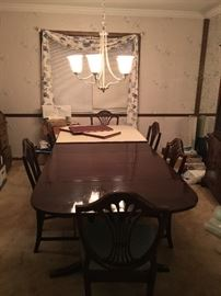 Dining room table with six chairs.
