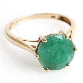 10K Yellow Gold and 2.75 CTS Emerald Ring: A 10K yellow gold ring featuring one center 2.75 cts round cut emerald mounted in a high prong setting.