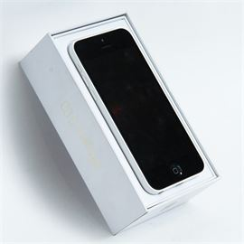 White iPhone 5S: A white Apple iPhone 5S with black face and screen, and with original box. Model number A1532.