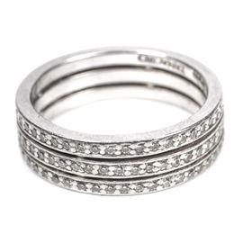Platinum and Diamond Tanagro Ring: A platinum and diamond triple band ring.
