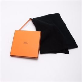 Hermès Black Cashmere Muffler: An Hermès black cashmere scarf featuring a textural diamond pattern. Brand and fabric care labels are hand sewn to one edge. The scarf comes wrapped in tissue in the original orange box.