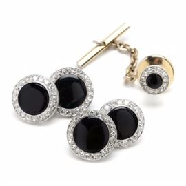Art Deco Janesich Platinum and Diamond Cufflinks and Tie Tack: A pair of Art Deco platinum, diamond and onyx cufflinks with the coordinating tie tack designed by Janesich Jewelers, founded in 1835 by Leopold Janesich, Trieste, Italy. Janesich jewelry was highly coveted by the Austrian aristocracy as well as the Italian bourgeoisie, their style after WWII focused on Art Deco in keeping with the fashion of the time. The cufflinks are designed with a round onyx disc surrounded by diamonds set in platinum.