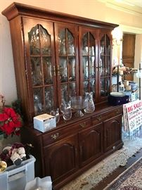 Buffet/hutch that matches the DR table & chairs.  It's filled with decanters and other glassware