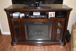 Cherry wood FREE STANDING ELECTRIC FIREPLACE was SOLD on line prior to the one day sale.