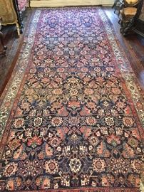 19th c. 16' x 10' carpet, damaged to center and at one end