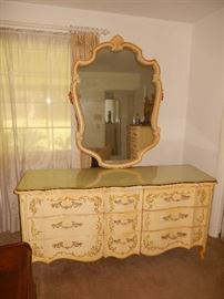 Triple dresser with matching floral painted design and mirror. Note: cut glass top.