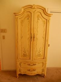 Outstanding armoire to match bedroom.