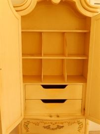 View at the inside of armoire.