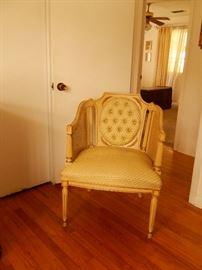 Hollywood Regency caned arm chair.