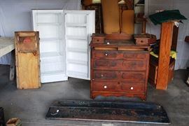 Vintage mechanics creeper, upright freezer, antique dresser with hand-cut dovetail joints, Chevrolet tailgate, wood corner entertainment center, foam (behind dresser)