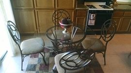 Glass top table set with 4 chairs 125