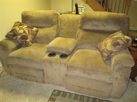 Dual reclining sofa with center storage