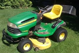 John Deere Model LA135 lawn & garden tractor with trailer & bagger