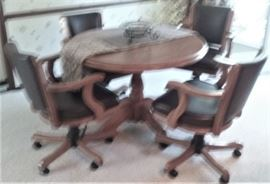 round table with 4 rolling chairs