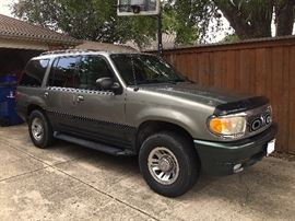 1999 Mercury Mountaineer 4X4. 210-hp V6 engine with a 5 speed automatic transmission w/OD getting on average 17mpg. Color is a 'Spruce Green' with a 'Graphite Grey' interior. One owner, 120K miles which averages to about 6,600 miles a year.. NICE!!