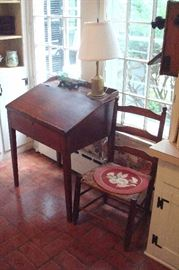 Mid 1800's lift top desk and shaker rush seat chair.